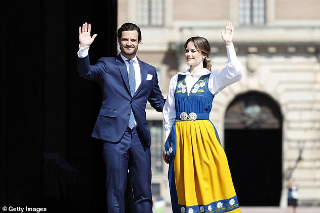 The couple beamed as they waved to crowds who had gathered at the Royal Palace in the country