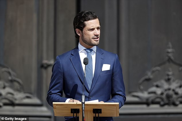 Prince Carl Phillip looked sombre as he was seen giving a speech at the event outside the Royal Palace in Stockholm