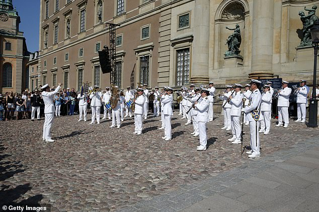 The royals watched as the Swedish Royal Navy Band played in front of the Royal Palace in Stockholm this morning