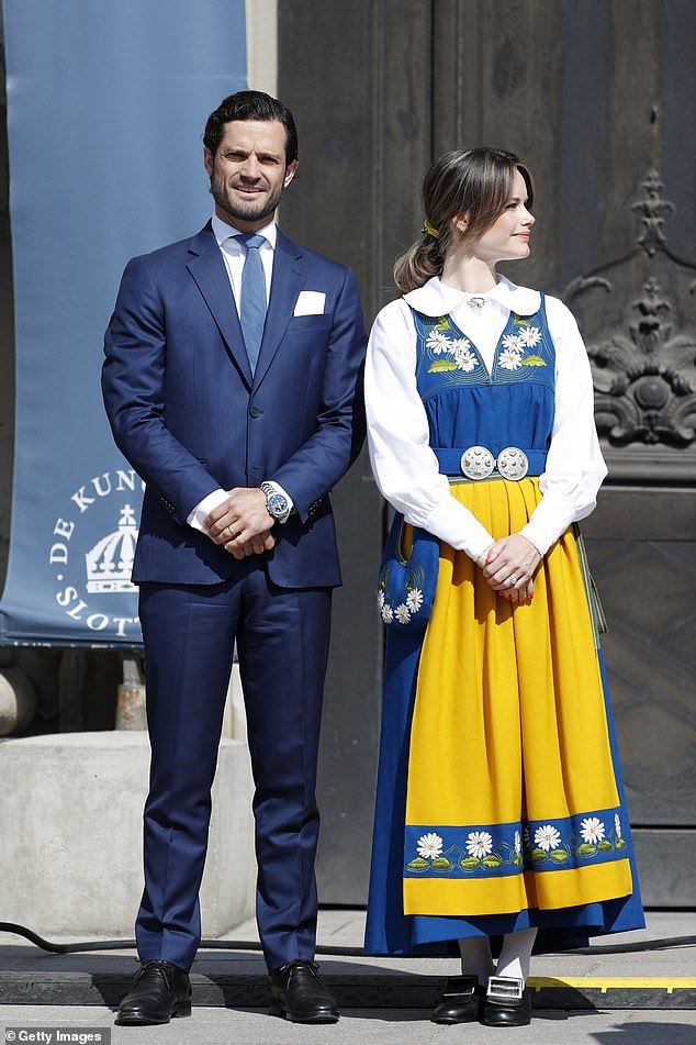 Prince Carl Philip joined his wife, looking handsome in a smart navy suit, with a white shirt and light blue tie (pictured outside the Royal Palace, Stockholm)