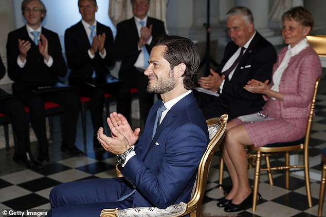 Prince Carl Phillip was seen applauding the winners of a scholarship award on Sweden