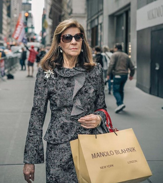 The account shows women running every day errands while looking exceptionally glamorous. Pictured: A woman wearing a  grey suit with a stunning broach goes shopping for designer shoes