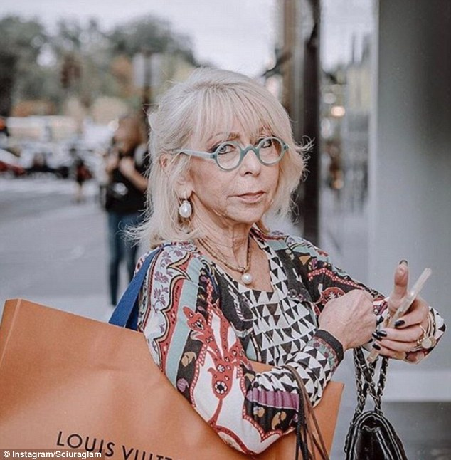 The account was created in December 2016 and has garnered over 126,00 followers. Pictured: A woman carries a Louis Vuitton shopping bag after hitting the designer boutiques