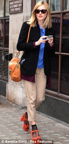 Fashion faux pas: Fearne teams socks and sandals with ill-fitting trousers