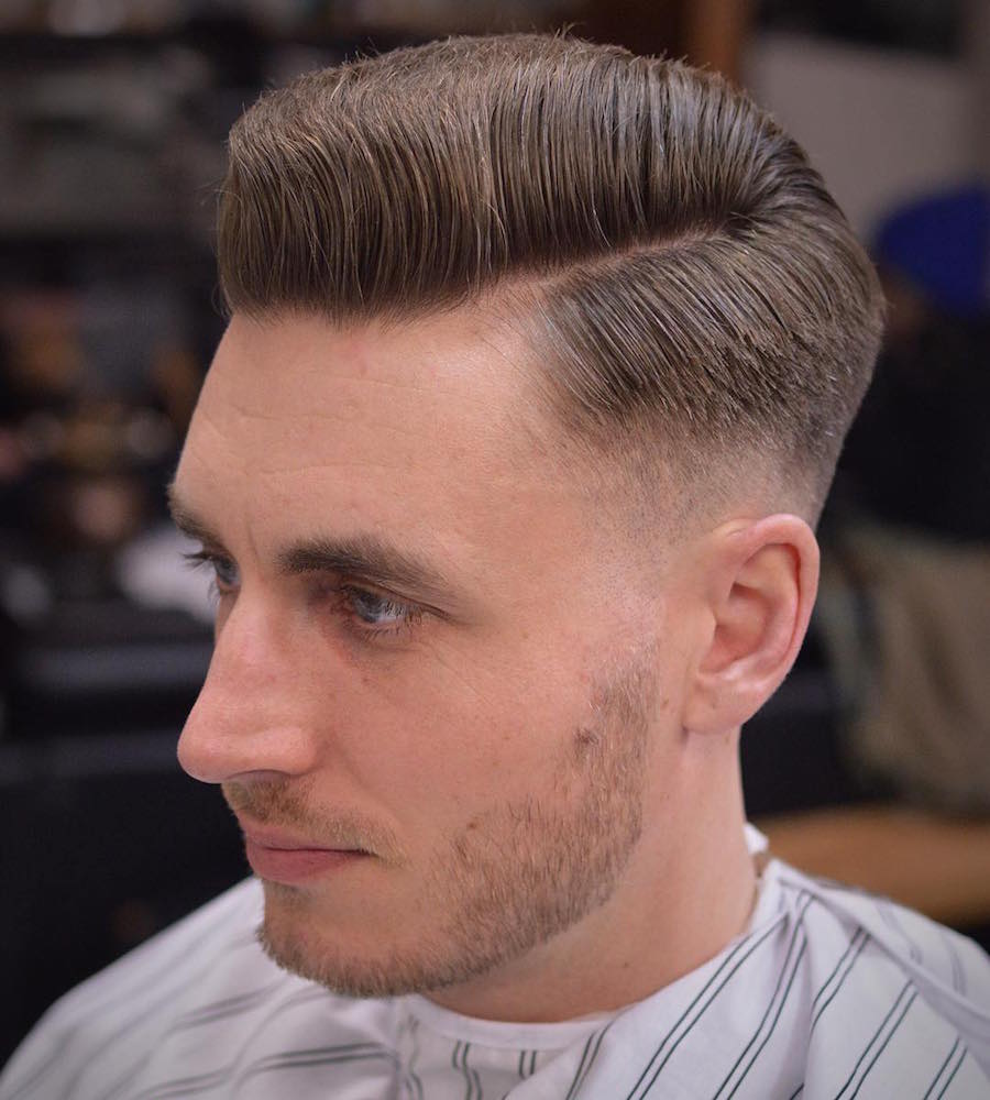 Skin fade side part medium length hairstyle for men