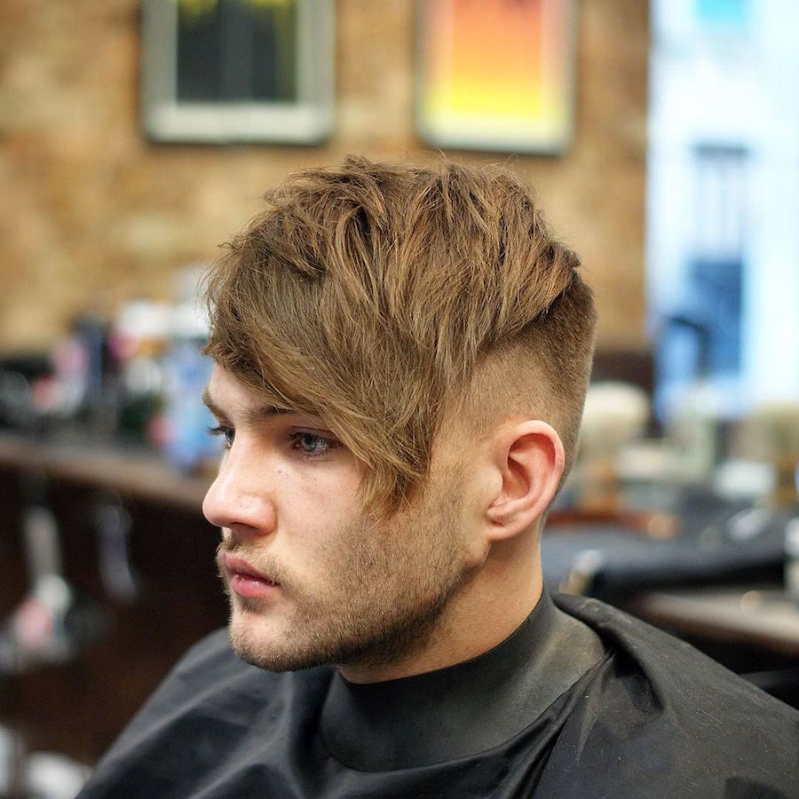 Textured hair and long fringe haircut for men