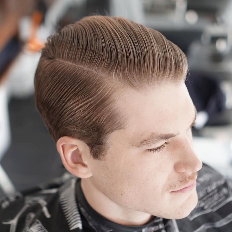 Classic slicked back hairstyle for men in medium length of hair