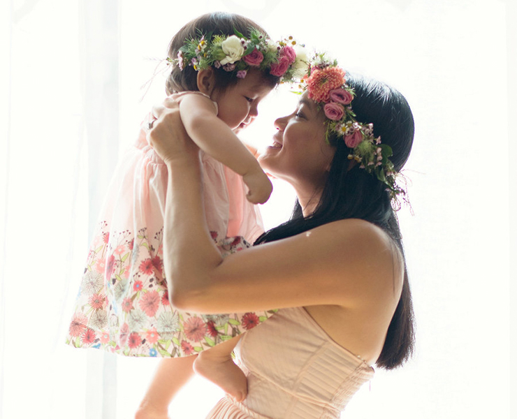 baby and mom with flower crowns